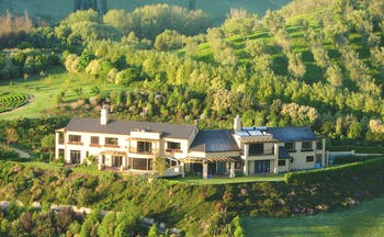 Beckenridge Lodge Hawkes Bay and Napier aerial view of large white building surrounded by trees