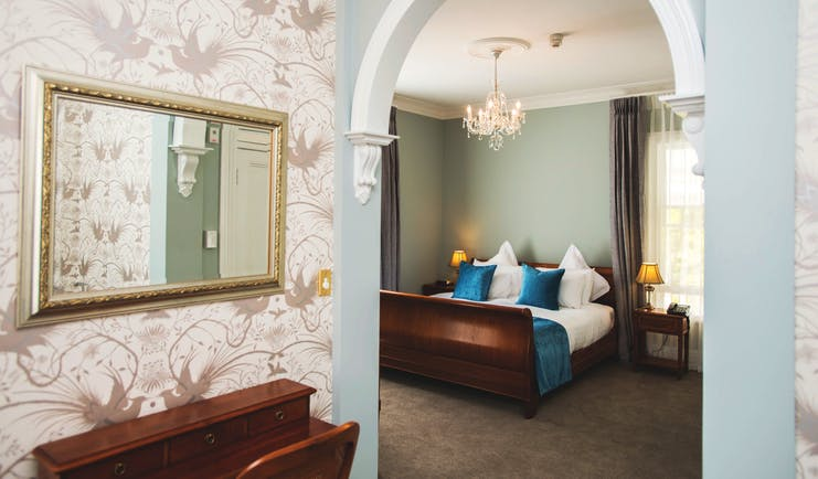 Mangapapa Hotel macron suite, bed, elegant architecture and decor, archway into bedroom