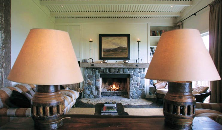 The Black Barn Hawkes Bay living room with sofas and stone fireplace