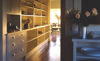 River Houses Hawkes Bay hallway with open shelving cabinets