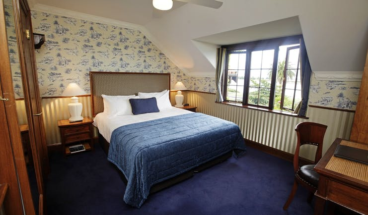 Grand Mercure Nelson Monaco Nelson Abel and Tasman bedroom with blue and white patterned walls and large window