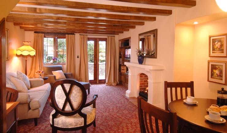 Grand Mercure Nelson Monaco Nelson Abel and Tasman cottage living room with sofa table fireplace and patio doors