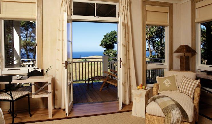 Kauri Cliffs veranda, view over the grass to the sea
