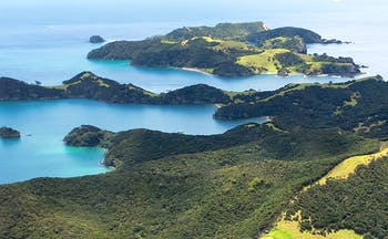 View from the air of green headland and islands with blue sea
