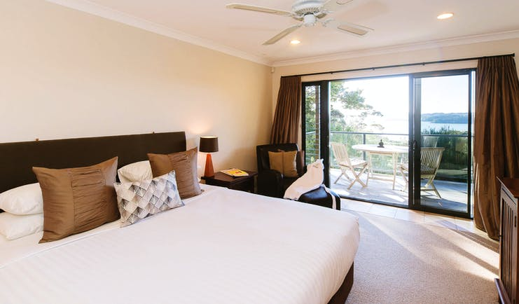 The Sanctuary at Bay of Islandas Northlands and Bay of Islands bedroom with patio doors to decked balcony