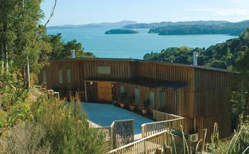 The Sanctuary at Bay of Islands Northlands and Bay of Islands exterior wooden buildings surrounded by trees near coast