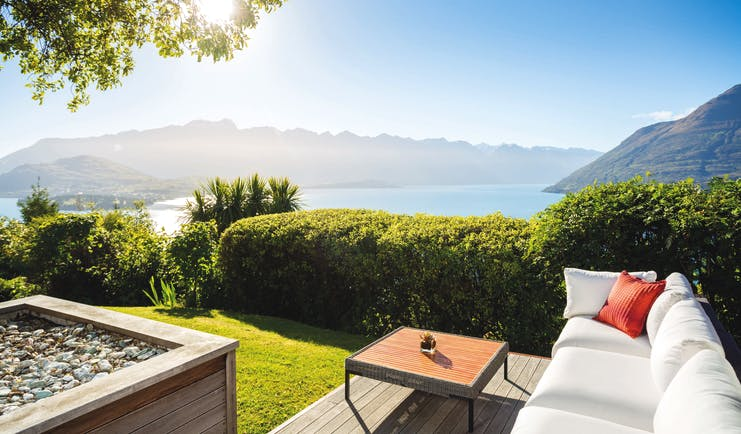 Azur Lodge Otago and Fiordland exterior view sofa in a garden overlooking mountains and water