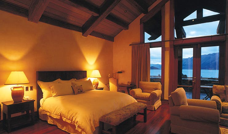 Blanket Bay Otago and Fiordland bedroom with seating area and access to patio