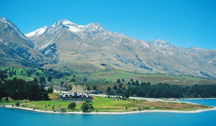 Blanket Bay Otago and Fiordland mountain lake lodge surrounded by lawns near lake and mountains