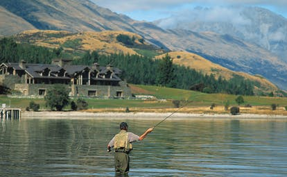 Blanket Bay Otago and Fiordland man fly fishing in a lake