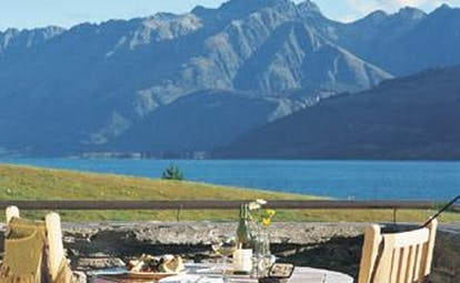 Blanket Bay Otago and Fiordland outdoor dining with lake and mountain view