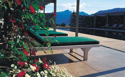 Blanket Bay Otago and Fiordland outdoor pool and green sun loungers