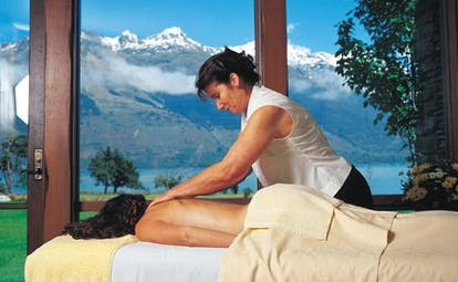 Blanket Bay Otago and Fiordland spa woman giving a massage with mountain view
