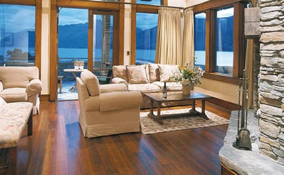 Blanket Bay Otago and Fiordland suite lounge with armchairs and access to terrace with lake view
