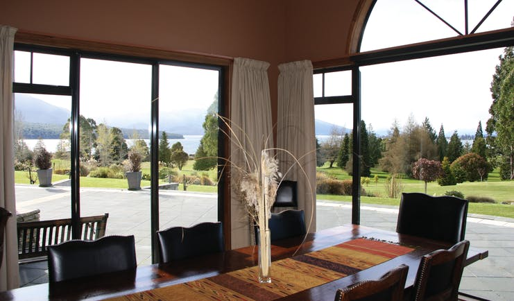 Dock Bay Lodge Otago and Fiordland dining room with large window and garden view