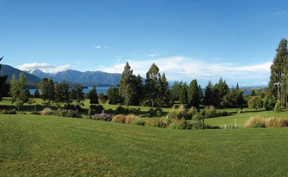 Dock Bay Lodge Otago and Fiordland view gardens with trees and mountain view