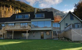 The Hidden Lodge Otago and Fiordland exterior lodge with large windows and balconies