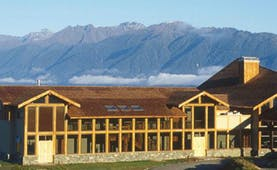 Fiordland Lodge exterior as the sun rises
