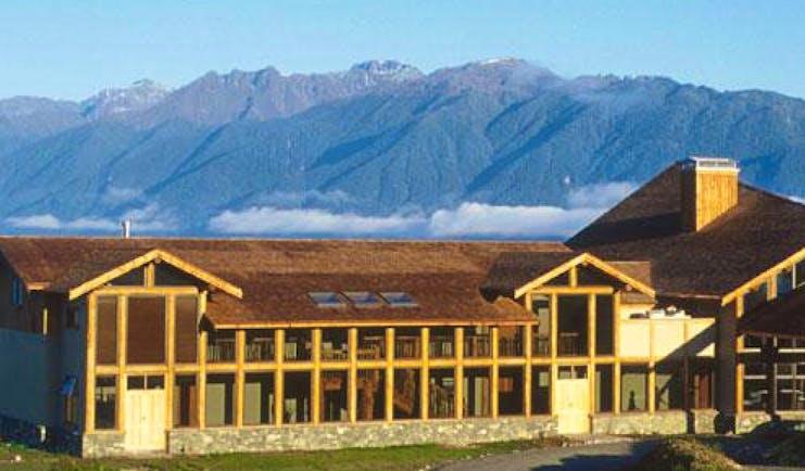 Fiordland Lodge exterior as the sun rises