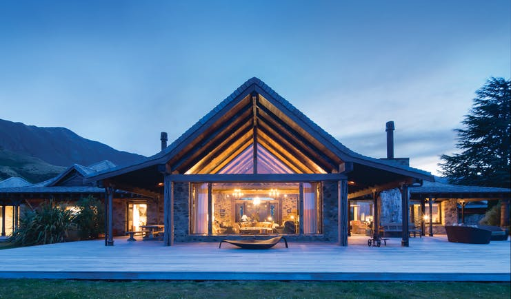 Mahu Whenua Otago and Fiordland exterior stone and wood lodge with floor to ceiling window