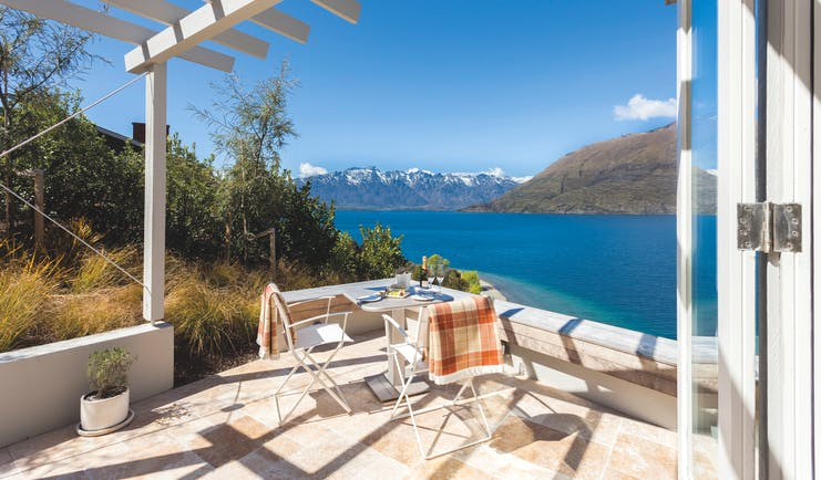 Matakauri Lodge Otago and Fiordland deluxe suite private terrace with mountain and lake view