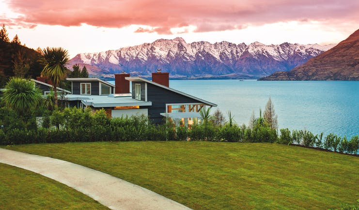 Matakauri Lodge Otago and Fiordland exterior lake wooden chalet with mountain and lake view