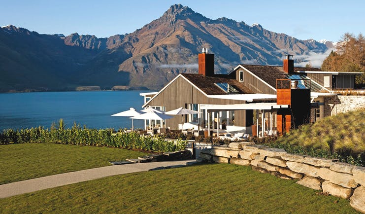 Matakauri Lodge Otago and Fiordland exterior wooden chalet with garden and mountain view