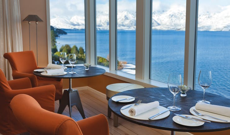 Matakauri Lodge Otago and Fiordland lower lounge dining area with lake and snowy mountain view