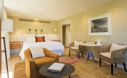 Matakauri Lodge Otago and Fiordland suite bedroom with seating area
