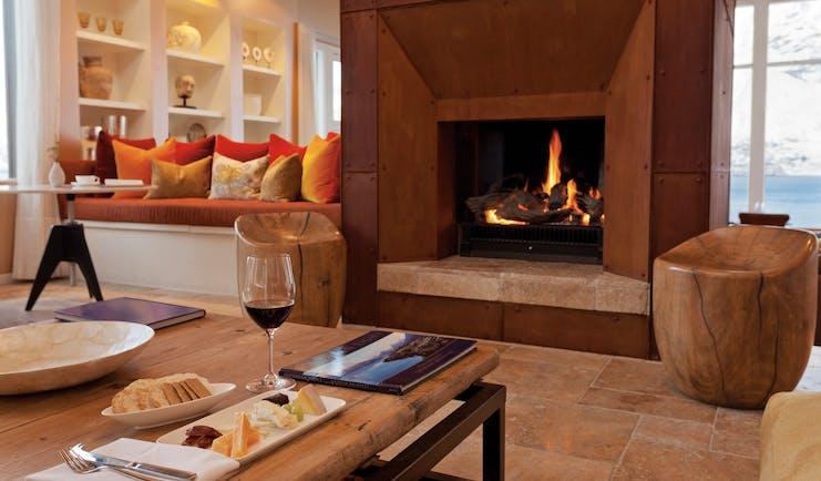 Matakauri Lodge Otago and Fiordland upper lounge area with sofa fireplace and mountain view