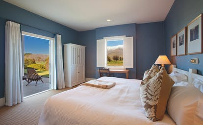 Millbrook Lodge Otago and Fiordland bedroom view with window and shutters patio and mountain view