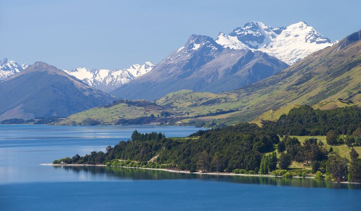 Lake Wakatipu near Queenstown, rugged mountains, snow capped mountain in background