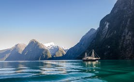Milford Sound in Fiordland, blue waters, looming mountains