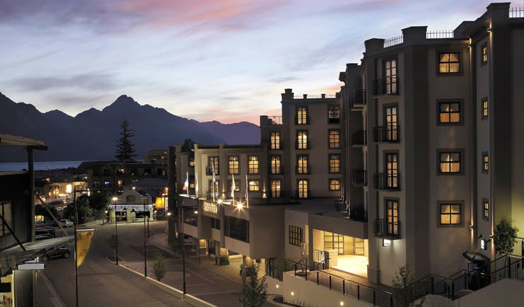 Sofitel Queenstown Otago and Fiordland outside night building with mountain in the distance