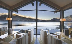 The Rees Hotel Otago and Fiordland mountain view lounge area with panoramic windows