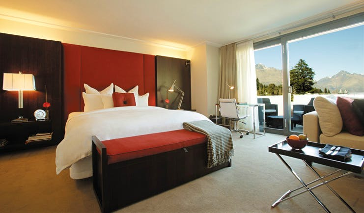 The Spire Otago and Fiordland suite with bed sitting area and patio doors to terrace