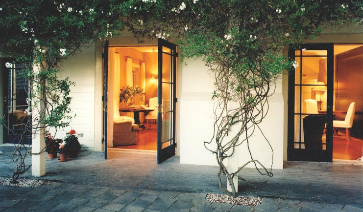 Martinborough Hotel courtyard with foliage and access to lounge