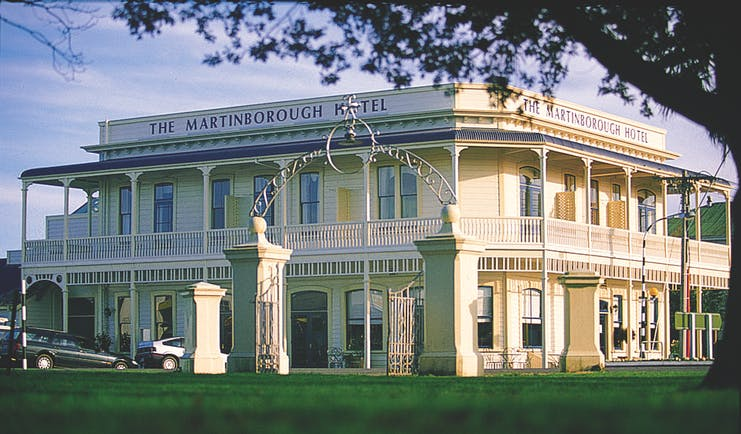 Martinborough Hotel exterior of a large cream building with balcony surrounding it