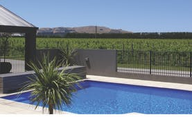 Peppers Parehua Wairarapa outdoor pool with vineyard and mountain view
