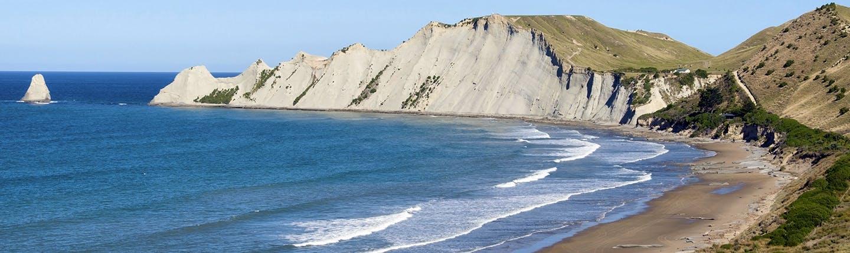 White cliffs bordering blue sea and beach
