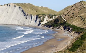 White cliffs bordering blue sea and beach