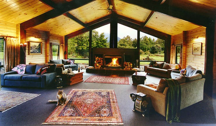 Lounge at Westwood Country House, sofas, roaring open fire, wide windows with views across the gardens