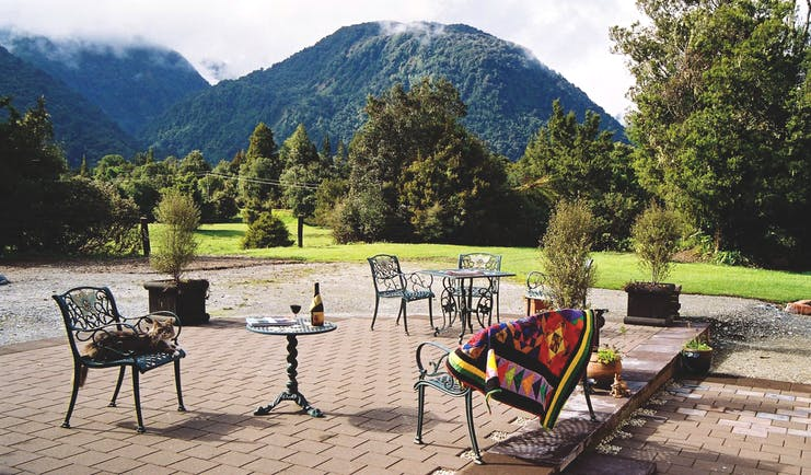 Westwood Country House patio, outdoor seating area, metal chairs, views of gardens, m