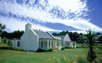 Wharekauhau Lodge Wairarapa cottage with columns and garden