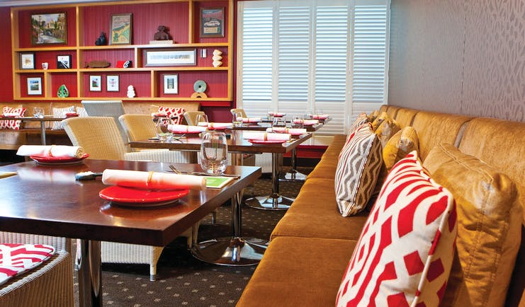 Bolton Hotel Wellington restaurant with red wall and bookshelf
