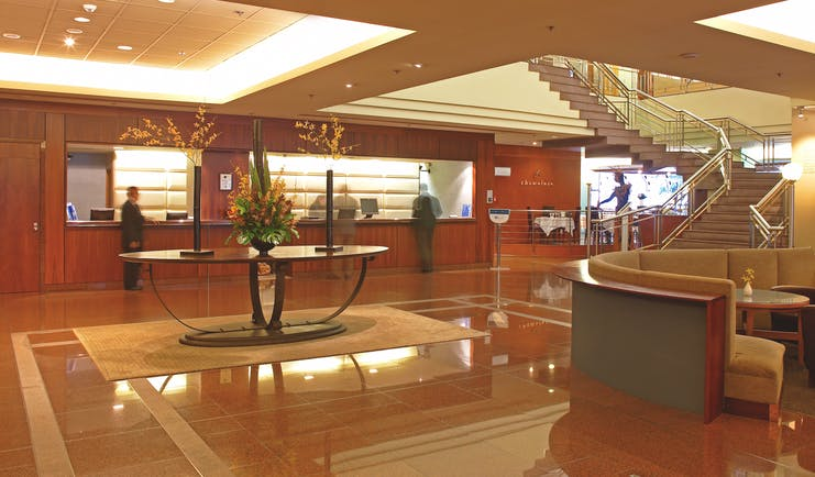 The Intercontinental Wellington lobby area with reception desk seating area and staircase
