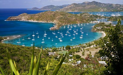English Harbour in Antigua, boats on the water, mountains in the background
