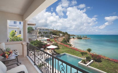 Blue Waters Antigua cove suites balcony overlooking pool and ocean