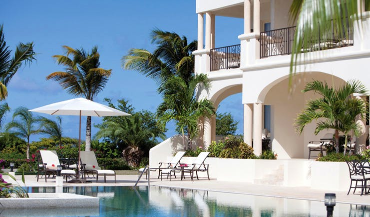 Blue Waters Antigua cove suites exterior pool and sun loungers