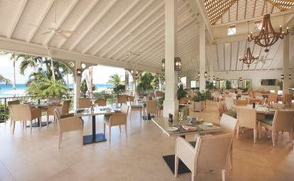 Blue Waters Antigua palm restaurant large dining area views over the sea